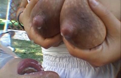 Kaori enjoys showing off her nice Asian tits
