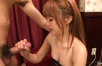 Suzuka Ishikawa Asian babe rubs a cock in her firm tits